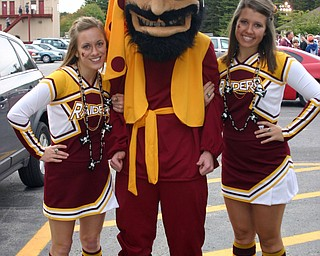 """""""South Range cheerleaders Dominique Bishop and Jesse Heck hang out with the Raider mascot at the Blitz tailgate party."""""""