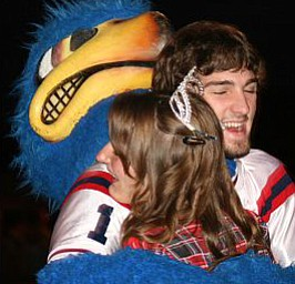 """Fitch's Homecoming Queen, Alissa Breakiron, congratulated by """"Freddy"""", Nate Choma."""
