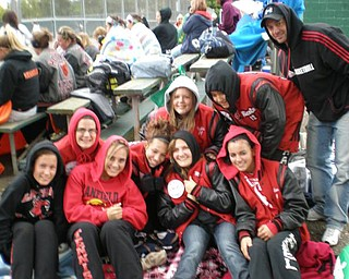 The Canfield Girls Tennis Team trys to keep warm together while waiting to hit the courts during sectional play in Canton, Ohio. From left Salena Nagy, Paige Zwicker, Maggie Kamenitsa, & Kaitlin Kaleel. Back row, Kelly Kuppler, Gabby Brant, Nicole Cordy, Nicole Chahine, and Coach Rob Stephens.