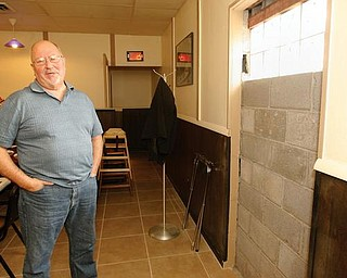 CRIME FIGHTER: Bob DeVicchio, owner of Bogey's Bar and Grill in Coitsville, is doing everything he can to prevent another break-in at his business. He blocked up the back entrance to the building, where burglars got in earlier this month.
