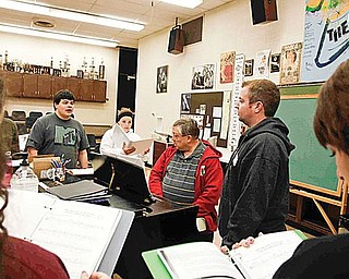 PRACTICE MAKES PERFECT: From left, Tyler Moliterno, Katelyn Deladurantey, Errol Kehrberg and David Mullane prepare for the Boardman Drama Guild's fall musical production. The group practices several days each week in the months leading up to the production.