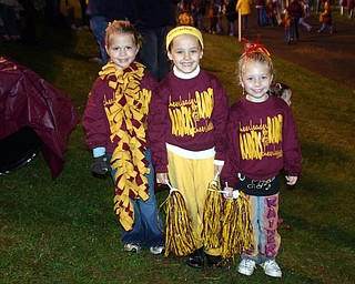 """Reagan Irons, Salli Dispenza, and Emili Boomhower cheered with the