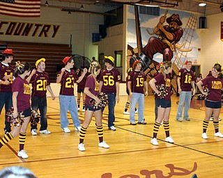 """South Range Senior football players help the Senior cheerleaders with