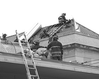 ON THE ROOF: Firefighters spent a couple of hours putting out a fire in the roof of the Warren post office on High Street Northeast that started at 3:20 p.m. Monday. Water used to put out the fire did some interior damage to the building. Workers using torches on the post office roof started the fire, the fire department said. The post office was closed Monday for Columbus Day.