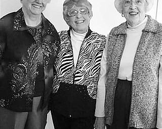 Special to The Vindicator FALL FASHIONS: Cards and games were on the agenda as guests attended a fundraising event sponsored by Columbiana Women's Club on Sept. 30 at the clubhouse on Main Street. A highlight of the event was a fashion show at which, from left, Janet Tatman, Roberta Myers and Miriam Hutson, club members, modeled the latest in fall fashions from Miriam's Selections shop on state Route 164, and from the club's Next to New Shop. Not pictured were Shirley Fitzpatrick and Judi Karcher, who served as chairs for the event.