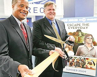 OPEN FOR BUSINESS: Youngstown Mayor Jay Williams, left, and Tobias Parrish, vice president of U.S. operations for VXI Global Solutions, pose after a ribbon-cutting ceremony. VXI opened its new downtown call center, which handles calls for DirecTV, with 40 employees Thursday.