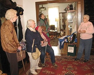 Special to The Vindicator tourists: Austintown Homemakers visited the historic McBride House at 27 Hager St., Hubbard, during a recent open house. They were welcomed by, at right, Cecilia Cooper, president of Hubbard Historical Society, who provided a guided tour of the home. Guests may tour the McBride House from 2 to 5 p.m. on the second Sunday of each month, or make special arrangements by calling the president at (330) 534-4247.