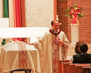 EULOGY: Monsignor Peter Polando delivers the eulogy for Capt. Ken Centorame, the Youngstown Police Department officer who died of leukemia Saturday. Monsignor Polando talked about Centorame's faith and family at services Thursday at St. Matthias Church in Youngstown.