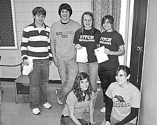 Special to The Vindicator NO TRICKS, JUST TREATS: Thirty members of Fitch Interact Club, with help from the club sponsor, the Rotary Club of Austintown, created 100 treat bags to be distributed to children at the Hope House of Youngstown. Among those involved in providing the Happy Halloween treats for the youngsters are, from left, kneeling, Miranda DeFurio and Liana DeFurio, and in back, Brandon Rivello, Zarek Bell, Sara Guittar, and Mariah DeFurio. During a recent meeting Eric Bohr, manager of Walgreen's on Meridian at Mahoning Avenue, challenged members to get involved in the Dec. 18 Christmas party on Lexington Avenue for residents of the No Limits and Ginnette Alternative Centers.