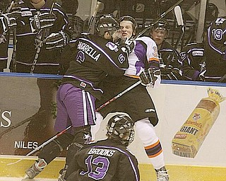PHANTOMS - (3) Andrej Sustr of the Phantoms gets checked into the boards by (6) Andrew Panzarella during their game Friday night. - Special to The Vindicator/Nick Mays
