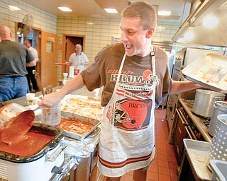 """The Vindicator/Geoffrey HauschildCo-Organizer and Member of the Columbus Knights of St. Dominic's Parish, Brian Antal, a resident of Poland, prepares spaghetti during a spaghetti dinner,benefiting Ed Port, at St. Dominic's Parish Center on Sunday afternoon. """"Double it up,"""" jokes Antal to a patron wearing a Cleveland Browns sweatshirt, """"Browns fans get double!"""""""