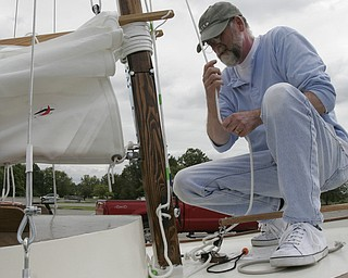 Bill Davis spent five years building the wooden sailboat William Harrow in the garage of his Girard home. He named the 19 foot boat for his grandfather.
