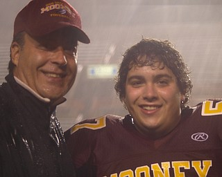 Father & son sharing a moment before the Mooney-Ursuline game.  Frank Sr. & Frank Lucurell Jr. on senior night.