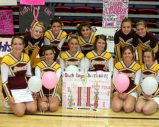 """""""South Range Cheerleaders earned $3500 for breast cancer research and awareness and took that donation to the Pink Ribbon Cheer Classic at YSU this past Sunday.  They were awarded trophies for first place """"One in a Million"""" for the largest coin drive, first place """"Best Banner,"""" and seond place """"Biggest Donation.""""  In the past 6 years, the South Range Cheerleaders have raised $17,500 for this worthy cause."""