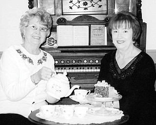 Special to The Vindicator JUST TEA-SING: Prepared to serve after completing arrangements for a Victorian Christmas High Tea on Nov. 8 at the Strock Stone House are, from left, Joyce Pogany, president of Austintown Historical Society, and Marge Goldner, co-chair of the event,