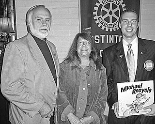 Special to The Vindicator TRAVELERS: At the Oct. 5 meeting of the Rotary Club of Austintown, the speakers were from left, Jim and Dawn Tallman of Niles. Jim Tallman is a past district governor and now chairman of the district foundation grant program. The Tallmans traveled to India to see the results from funding of between $300,000 and $400,000 that District 6650 has sent there over the past six years. They visited a microfinance conference, which offers grants to women to start businesses and then sponsor others with profits. They took part in a Polio Day, in which 160 million children were immunized. They toured many Rotary water and solar cooking projects, a deaf school and Pardata Pardadi school for girls who can learn a trade to support themselves. At right is Brian Laraway, Austintown Rotary president, who presented a book in honor of the speakers to be donated to Woodside Elementary School Library.