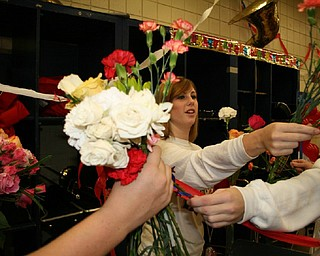 The Fitch Seniors' tradition of exchanging flowers before their last home game is carried on by Sami Ragan.
