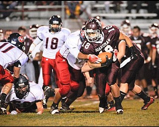 Boardman's (18) Nick Buonavolonta moves the ball early on Friday night in Boardman against Austintown. Photo/Mark Stahl