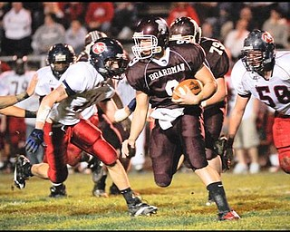 Boardman's (9) Rob Boyd  scrambes for yards against Austimtown during their game on Friday night. Photo Mark Stahl