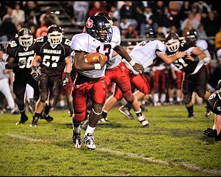 Austintown's Will Mahone (13)moves the ball against Boardman during their game n Friday night. Photo/Mark Stahl