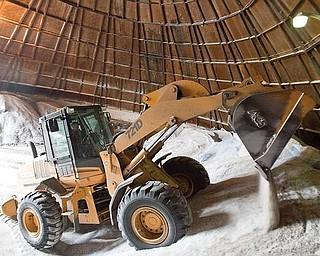 Boardman Township Road Department piles salt inside a silo the township maintains off Market Street.