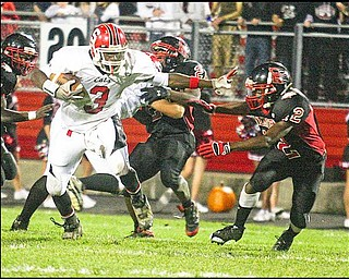 FOOTBALL - (3) Jermayne Brooks of Struthers breaks away from (12) Chris Copeland for a long gain during their game Friday night. - Special to The Vindicator/Nick Mays