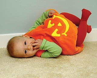 LYING DOWN ON THE JOB: Camden Cox, Austintown, appears to be taking a rest after a day of looking adorable in his costume.