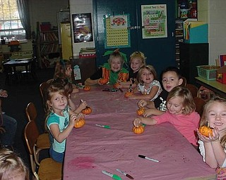 The Green Team's pumpkin recycling lesson was presented to these students in Canfield Presbyterian Church Weekday Preschool's morning class.