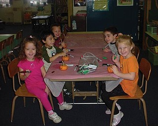 Students at Canfield Presbyterian Church Weekday Preschool's afternoon class decorated pumpkins.