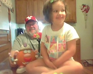 Mikayla Upright, 4, and her poppy, Bob Savon, Youngstown make a princess pumpkin together.