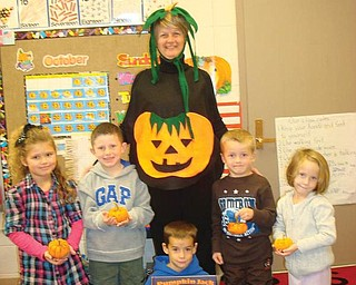 Peg Flynn from the Green Team visited Mrs. Bonarigo's kindergarten class at Poland Union Elementary School and read 'Pumpkin Jack  to the students. Afterward, each student received a mini-pumpkin to decorate and to compost later. Students pictured wit Peg are, standing from left, Sophia Diamandis, Austin Lambert, Gavin Wess and Margaret Dodge, and Jack Pepperney, holding the book. All of the students are from Poland.