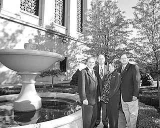 The Vindicator/Robert K. Yosay HELPING OTHERS: For years, the Monday Musical Club has been organizing collection events to benefit the Rescue Mission of the Mahoning Valley. Some of those involved in the effort are, left to right, Monday Musical board members Richard Esposito, president; Walter DeBald; and Joan Gallitto, secretary; and Don Rosa, Rescue Mission board president.