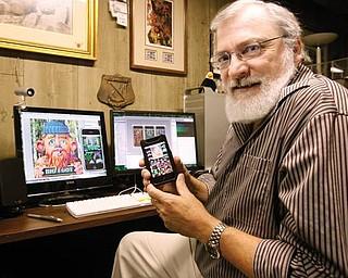 The Vindicator/Robert K. Yosay -----Tom Antonishak, a Poland artist who developed an iPhone application.---10282009