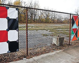 THEFT: An empty space marks the location of a stolen piece of art on a fence on Wick Avenue on Youngstown's North Side. Thirty seven artworks were hung on the fence Oct. 24. Three were stolen early Saturday morning. The urban beautification project is the work of Art Youngstown.