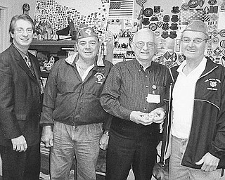 Special to The Vindicator SHARING THE WEALTH: Funds to benefit needy veterans and their families were raised during a yearly reverse raffle and a Chinese auction sponsored by Catholic War Veterans Post 1292 of Youngstown at St. Mary Church in March. Mark Bell, director at the Veterans Administration Clinic on Belmont Avenue, at left, accepted the $1,200 donation during a meeting with, from left, Al Bisker, CWV Post 1292 trustee; Lovel Henderson Jr., volunteer service officer at the clinic; and Gary Barnes, commander of CWV Post 1292.