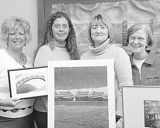 Special to The Vindicator PICTURE THAT! A few of the donated pieces of art to be auctioned as a benefit for the Ursuline Sisters HIV/AIDS Ministry on Saturday are displayed by, from left, Cheryl Streb-Baran, clinic director; Jessica Sheppard, child and family program director; Brigid Kennedy, associate director; and Sister Kathleen Minchin, executive Director.