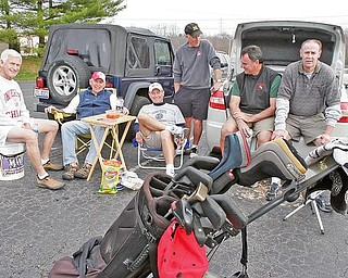 ENJOYING THE WEATHER: Taking a break after a round of golf at the Mahoning Country Club in Girard are, from left, Skip Robinson, Bill Murphy, Tom Case, Pete Morrison, Marty Willmitch and Frank Richards. With temperatures in the mid-60s on Monday, area golfers got a chance to hit the links.