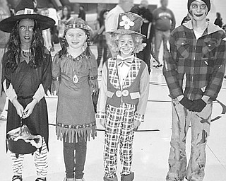 Special to The Vindicator FALL FASHIONS: During a fall fair at Jackson Milton Elementary School, from left, Olivia Johnson, Korie Gross, Miranda Keck and Katie Matasy were chosen as the best dressed for fall haunting. Not pictured are Frank Yacucci, Dave and Shirley Pinney, Leah Condon and Steve Marshall, members of the Kiwanis Club of Western Mahoning County who judged the fall fashion event.  Brian Higgins, executive director of Big Brothers Big Sisters, was a recent speaker at the Kiwanis Club, which meets at 6 p.m. Wednesdays at A La Cart in Canfield. The club recently conducted a cereal drive to benefit Operation Blessing in Canfield.  For more information contact Barb Smith at (330) 502-1460.