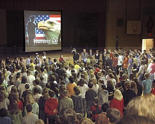 The Vindicator/Robert K. Yosay --- A A salute to veterans as the Canfield Middle School students  - interviewed  veterans and told their stories. They also had a speaker who was once a student there as the main speaker  YPD officer William Ward and former Marine 11/11/2009