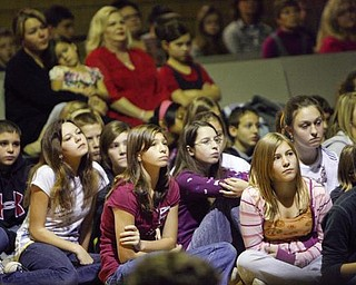The Vindicator/Robert K. Yosay --- students listen intently as  A salute to veterans at the Canfield Middle School students  - interviewed  veterans and told their stories. They also had a speaker who was once a student there as the main speaker  YPD officer William Ward and former Marine 11/11/2009