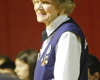 The Vindicator/Robert K. Yosay --- Betty Harris wore her WAC outfit as she received a round of applause after the students heard her story of her service to her country as  A salute to veterans as the Canfield Middle School students  - interviewed  veterans and told their stories. They also had a speaker who was once a student there as the main speaker  YPD officer William Ward and former Marine 11/11/2009