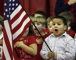 "The Vindicator/Robert K. Yosay -----Carlos  Irizarry sings 'God Bless America"" as he and his fellow students put on a show for the veterans in attendance at the  West Elementary School in Boardman 