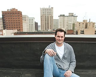 SKY'S THE LIMIT: Craig Zamary, founder of Green Energy TV, sits atop the Youngstown Business Incubator downtown.