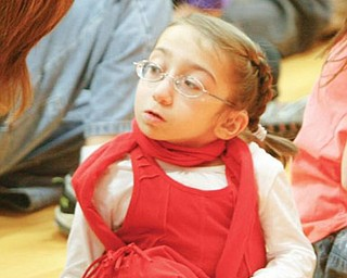 Suzie Mazzocco was surprised with tickets to a Miley Cyrus concert. The tickets and other gifts were presented at an assembly at Struthers Elementary School on Wednesday. Suzie has a rare bone-growth disorder that results in dwarfism. She has had 17 surgeries.