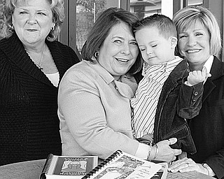 The Vindicator/William D. Lewis ANGELIC: Preparing for the Angels for Easter Seals Annual Holiday Brunch and Sweet Shoppe are, left to right, co-chairs Nancy Leicht and Mary Celeste VanSickle, holding Christian Trella, 3; and President Phyllis Bacon. The Angels will be selling more than 30 varieties of homemade cookies, among other types of baked goods.