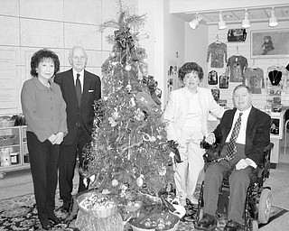 Special to The Vindicator READY for holidays: Looking forward to the upcoming holiday season after completing arrangements for the 39th annual American Holiday Fine Arts and Crafts Show and Sale at the Butler Institute of American Art are, from left, Florence Wang, chairwoman, and C. Gilbert James, Camilla Geordan, and John MacIntosh, co-chairs. Completing the holiday show committee as a co-chair but not pictured is John Grdic.