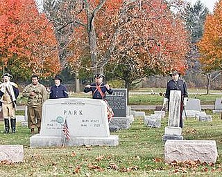 SALUTE: War re-enactors honor the fallen of three wars at a ceremony Sunday at Canfield Cemetery.
