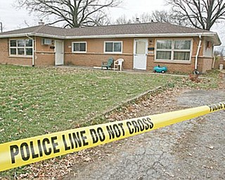 SHOOTING SCENE: This is the home at 3022 Northgate Drive, Liberty Township, where a woman and a female juvenile were found shot to death late Sunday. The names of the victims were not released Monday.
