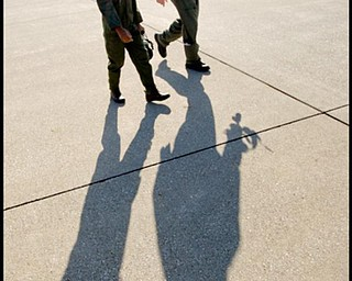 The Vindicator/Robert K. Yosay -----Long shadow proud day...-  Alan Hinton 11 of Youngstown   and his mentor / pilot of the C-130  Capt Brian Hodor head for the plane - Alan was pilot for a day at the Youngstown Airbase - 11182009
