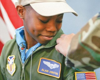 REPORTING FOR DUTY: Alan, of Youngstown, gets his bars as an honorary Air Force Reserve second lieutenant. The sixth-grader at Youngstown Community School suffers from sickle cell anemia.